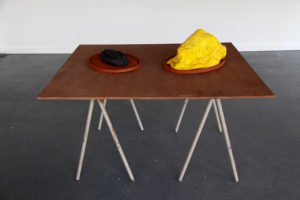 Bread, Butter - carbonised loaf of bread, road marking thermoplastic, glass ballotini, terracotta platter, 2016